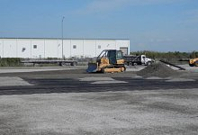 Slag and polymer surfacing for heavy duty industrial storage area.
